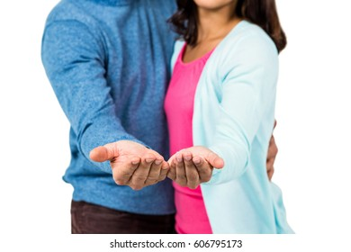 Midsection of couple gesturing against white background