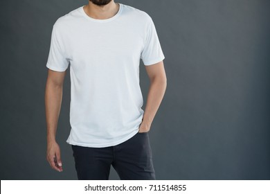 Mid-section of man posing against grey background