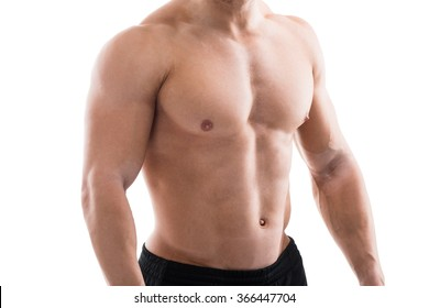 Midsection of muscular man standing against white background