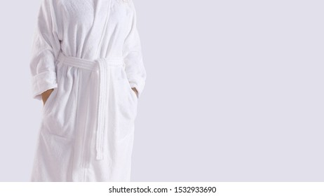 Midsection of a person in white bathrobe