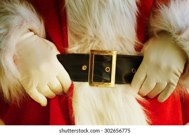 Midsection of Santa Claus with hands on stomach