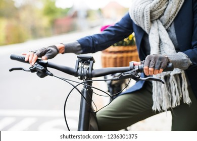 A midsection of senior woman with electrobike outdoors in town.