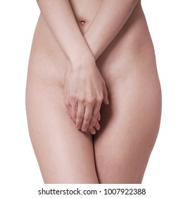 midsection of unrecognizable naked woman covering her private parts or genital area with hands, isolated on white
