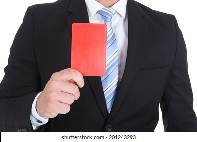 Midsection of young businessman showing red card over white background