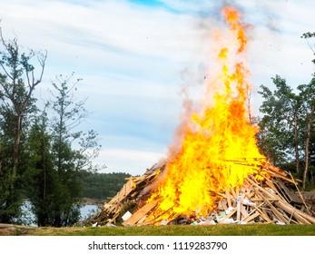Midsummer bonfire at closeup at waterfront