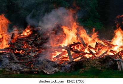 Midsummer bonfire of old house