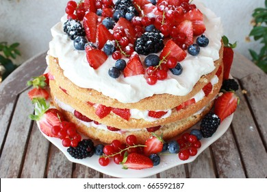Midsummer cake with fruits and vanilla cream