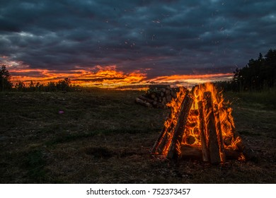 Midsummer fire in Latvia as a reflection of breathtaking sunset