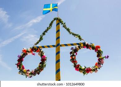 Midsummer flower wreath with Swedish flag