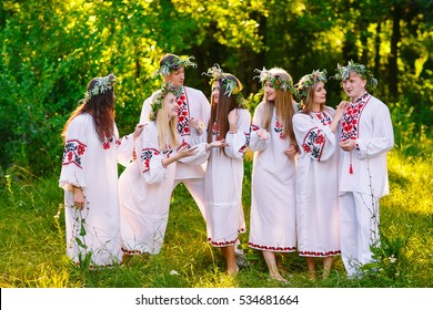 Midsummer. A group of young people of Slavic appearance at the celebration of Midsummer.