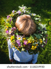 Midsummer in Latvia: celebration of Ligo - a young girl wear a flower crown in sunny day.