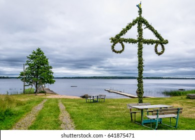 Midsummer maypole on the lake coast