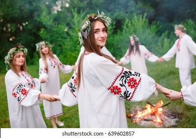 Midsummer. Young people in Slavic clothes revolve around a fire in the Midsummer. .