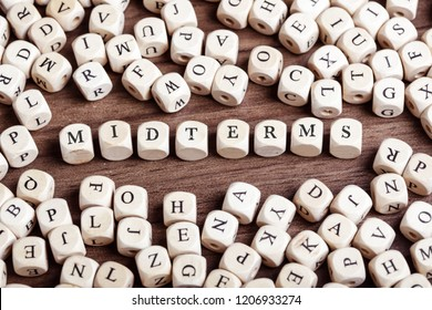 Midterms word in letters on cube dices on table.
