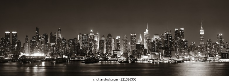 Midtown Manhattan skyline in black and white at dusk panorama over Hudson River