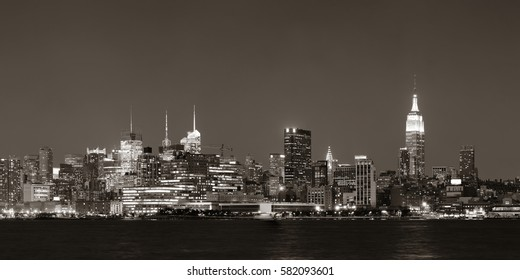 Midtown Manhattan skyline black and white at dusk panorama over Hudson River