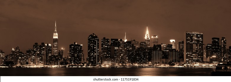 Midtown Manhattan skyline at dusk panorama over East River