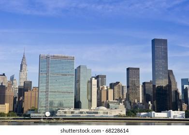 Midtown Manhattan skyline on a bright blue day