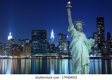 Midtown Manhattan Skyline and The Statue of Liberty at Night, New York City
