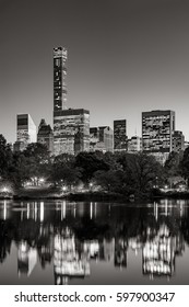 Midtown skyscrapers reflecting upon the Central Park lake at twilight. Black & White. Manhattan, New York City