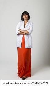 mid-twenty Filipino woman wearing a lab coat and a low cut orange dress