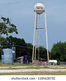 Midway, Texas / USA - June 29 2008: Multi-Column Elevated Water Tower painted with the town population.