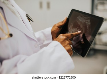 Midwife looking at a sonogram