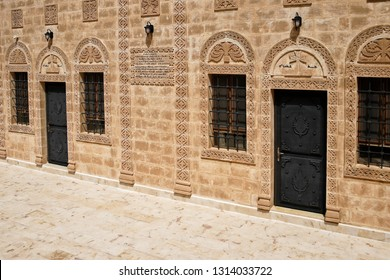 MIDYAT, TURKEY — MAY 5, 2011. Intricate carvings decorate the stone facade, doors, and windows of a building at Deyrulzafaran Monastery in Eastern Anatolia.