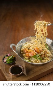 Mie Godog Jawa. Popular Javanese comfort food of yellow noodles with chicken, meatballs, vegetables and duck egg in chicken broth. Mie Jawa. Mie Godok