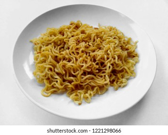 Mie Indomie Goreng Indonesian Food that is simple and often made at home. Fried noodles with white background. Indonesian Street Food.