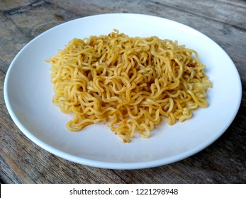 Mie Indomie Goreng Indonesian Food that is simple and often made at home. Fried noodles with wood background. Indonesian Street Food.
