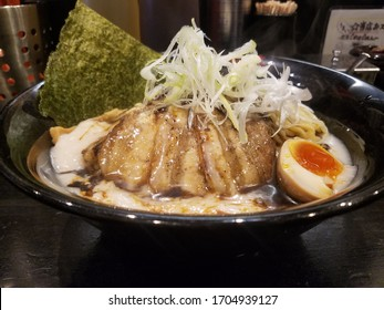 Mie, Japan - March 22, 2020 : Oiled Ramen Noodle  With Toppings.