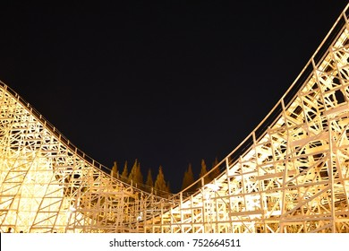 MIE, JAPAN - NOVEMBER 5, 2017 : White Cyclone, the white wooden roller coaster track scenery among clear night sky in winter as background at Nagashima spa land amusement park