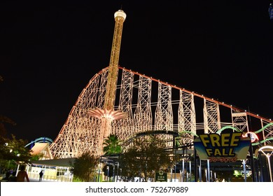 MIE, JAPAN - NOVEMBER 5, 2017 : the night scenery of drop tower with roller coaster called steel dragon 2000 and clear night sky in winter as background at Nagashima spa land amusement park