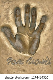 Miedzyzdroje, Poland, 15 August 2018:  A handprint of famous Polish actor Jan Nowicki made in a brass plate