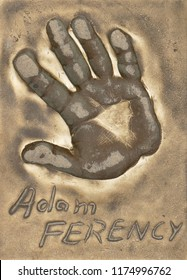 Miedzyzdroje, Poland, 15 August 2018:  A handprint of famous Polish actor Adam Ferency made in a brass plate