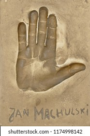 Miedzyzdroje, Poland, 15 August 2018:  A handprint of famous Polish actor Jan Machulski made in a brass plate