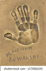 Miedzyzdroje, Poland, 15 August 2018:  A handprint of famous Polish actor Wladyslaw Kowalski made in a brass plate