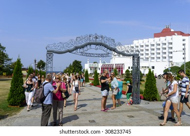 "MIEDZYZDROJE, POLAND - AUGUST 16: Tourists walk through the ""Avenue of Stars"" on 16 August 2015 in Miedzyzdroje, Poland. It is way with Polish actors handprints on sidewalk."