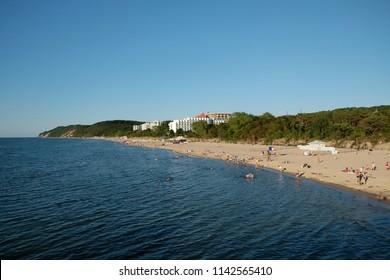 Miedzyzdroje, Poland - July 24, 2018: People walking on the beach in Miedzyzdroje
