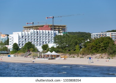 MIEDZYZDROJE, POLAND - JUNE 28, 2018. New hotel building with cranes near Amber Baltic Hotel and beach in Miedzyzdroje in Poland.