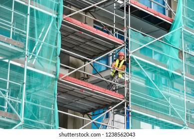 Miedzyzdroje, Poland, September 27, 2018: A smiling worker on scaffolding.