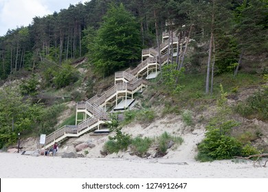 MIEDZYZDROJE, POLAND-JUNI 8, 2018:Wooden stairs from a landscape park to the beach in Miedzyzdroje