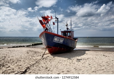 MIEDZYZDROJE, POLSKA-JUNI 6, 2018:A fishing boat moored on the beach in Miedzyzdroje