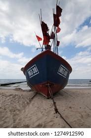 MIEDZYZDROJE, POLSKA-JUNI 6, 2018:A fishing boat moored on the beach in Miedzyzdroje