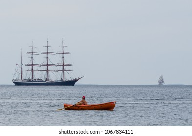 MIEDZYZDROJE, WEST POMERANIAN / POLAND - 2017: A lifeguard at sea on the background of sailing ships