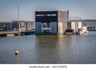 Mielno, Poland - May 12, 2017: Houseboats for rent on Lake Jamno in Mielno town on the Baltic Sea coast
