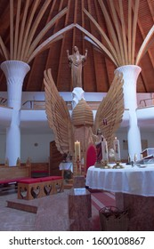 Csíkszereda Miercurea Ciuc,  April 21, 2018 In the Millennium Church, the shape of the winged altar is reminiscent of a beehive. Behind it is a statue of the Resurrection sculpture.