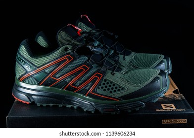 Miercurea Ciuc, Romania- 22July 2018: Pair of new Salomon X-Mission 3 sport shoes isolated on black background.
