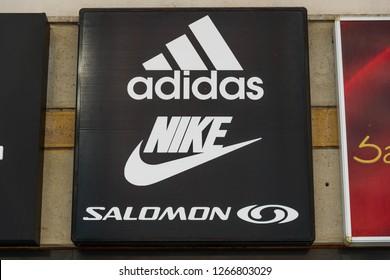 Miercurea Ciuc, Romania-25 December 2018: Adidas, Nike and Salomon logos on the street.
